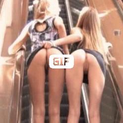 Гифка две лесбиянки на эскалаторе ласкают свои жопы